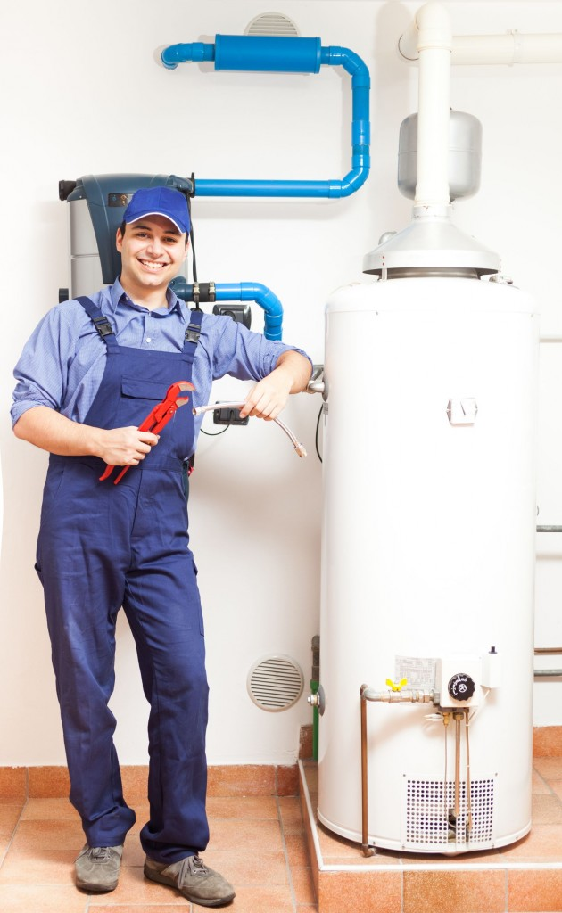 17184273 - smiling technician repairing an hot-water heater